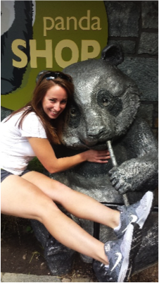 Lauran posing with her favorite animal, the giant panda,  while visiting the National Zoo, DC